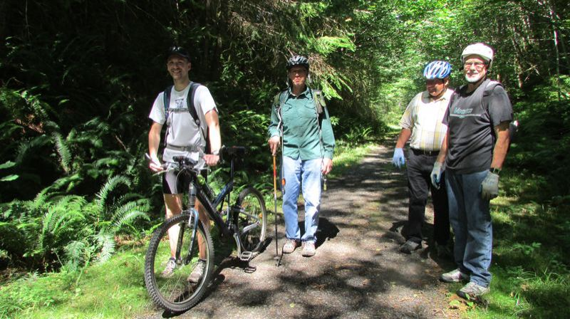 SPOTLIGHT PHOTO: COURTNEY VAUGHN - The Longview (Wash.) Border Crossers will welcome enthusiasts to a walk on the Crown Zellerbach Trail, pictured in this photo with Andy Haugen, Joel Haugen, Larry Lehman and Pete McHugh in Joel Haugen's efforts to expand it in 2014, on Saturday.