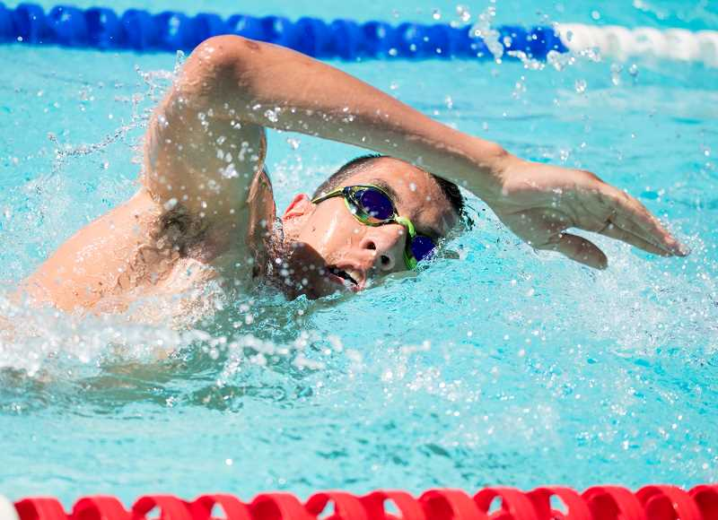 LON AUSTIN/CENTRAL OREGONIAN - Emilio Todd swims the 100 meter freestyle at Prineville's home meet earlier this year. Todd won three races this past weekend at the Klamath Basin Open.