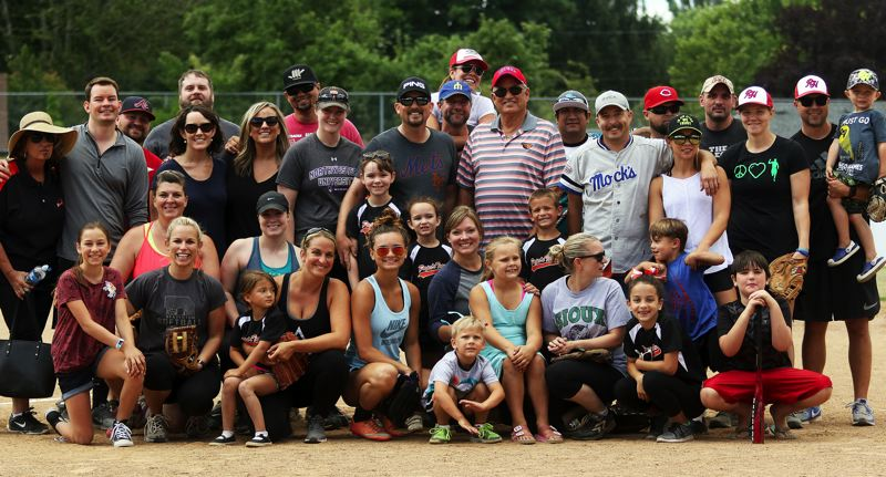 DAN BROOD - Players and spectators gathered at Sunday's second-annual Gary Edwards Memorial Softball game.