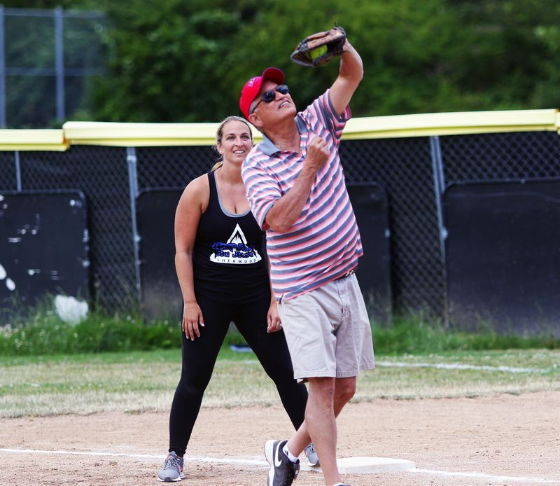 DAN BROOD - Lem Montoya, who coached with Gary Edwards, makes a catch at first base during Sunday's game.