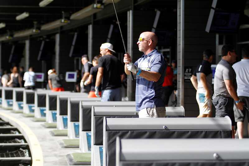 HILLSBORO TRIBUNE PHOTO: WADE EVANSON - TopGolf Tour competitors get some warm-up shots in prior to the competition July 16 at TopGolf in Hillsboro.