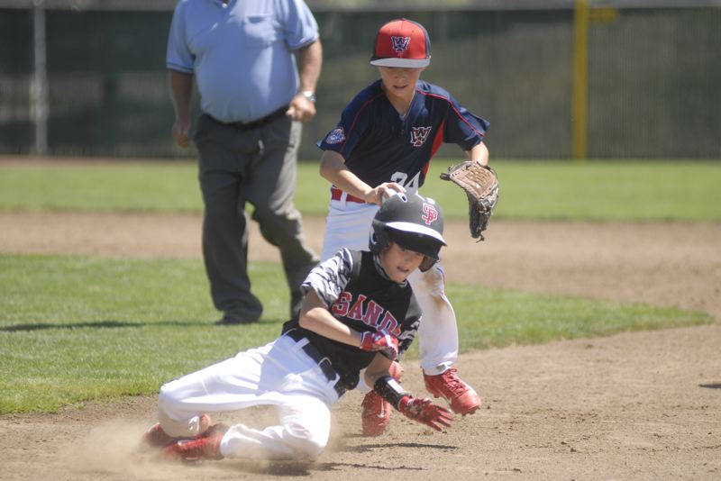 SANDY POST: MATT RAWLINGS - Caleb Rinard gets tagged out between first and second in Sandy's 8-7 loss.