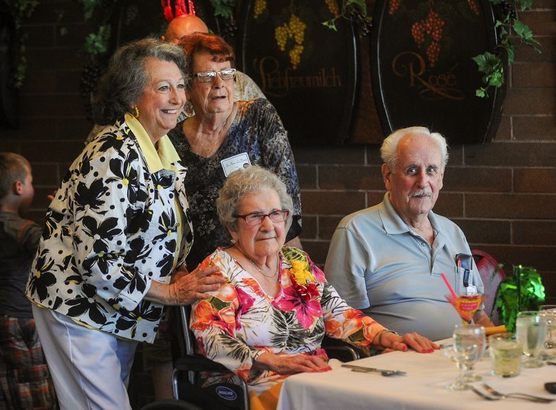 OUTLOOK PHOTO: JOSH KULLA - Marguerite Inman, left front, poses for a birthday photo with family members at her 100th birthday celebration.