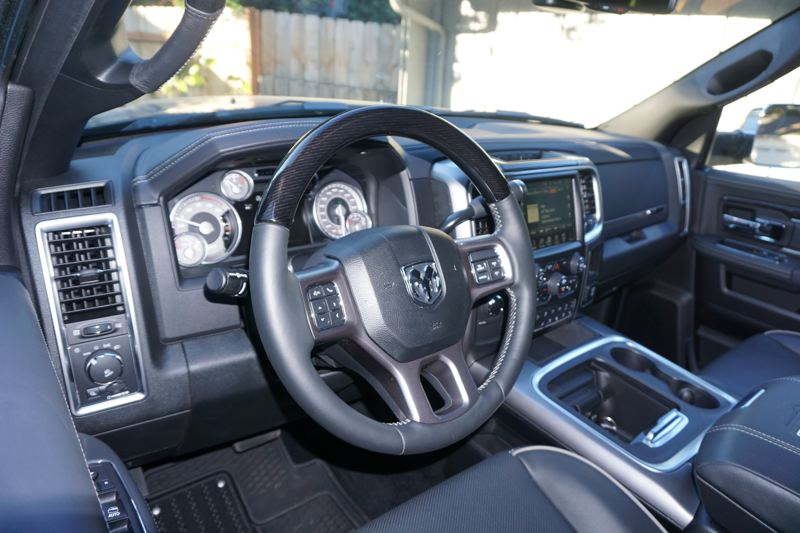 PORTLAND TRIBUNE: JEFF ZURSCHMEIDE - Inside, the Ram 2500 is spacious and comfortable. A large center console serves as a desk and storage area for laptops or tools, and you can power anything you need from the 115-volt power outlet.