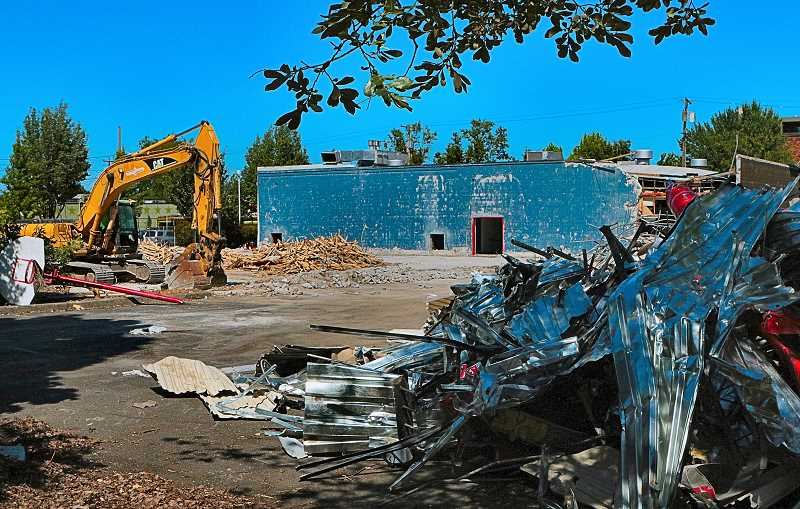 DAVID F. ASHTON - Only two days after the demolition began, the Fred G. Meyer Memorial Boys & Girls Club gymnasium in Westmoreland was reduced to splinters and dust.
