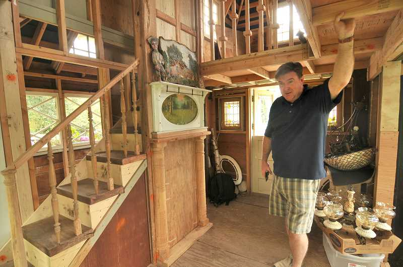 SPOKESMAN PHOTO: VERN UYETAKE - John Stanhope shows off the two-story Troll Lodge, now for sale.