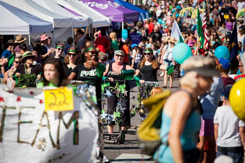 CONNECTION FILE PHOTO - Organizers estimate that around 5,000 people are in attendance each year at the Multnomah Days parade and street fair, held this year Aug. 19-20.