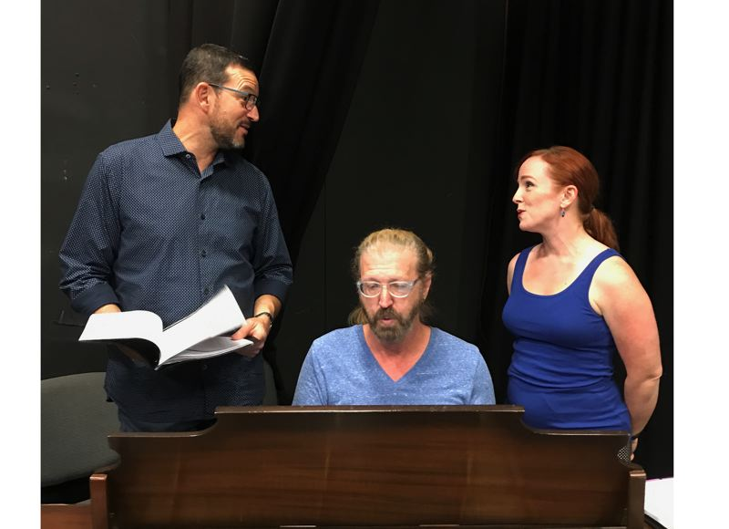 PHOTO BY RON PALMBLAD - Dirk Foley, left, and Keri Geni Darner work with David Hastings rehearsing for 'I Do, I Do,' the New Century Players musical opening Sept. 8. All three will perform in the fundraiser 'Give My Regards to Broadway' on July 29.