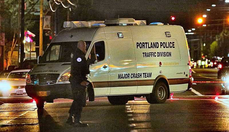 DAVID F. ASHTON - The Portland Police Bureau Traffic Division Major Crash Team arrives at the scene of a deadly pedestrian vs. vehicle crash on Powell Boulevard.