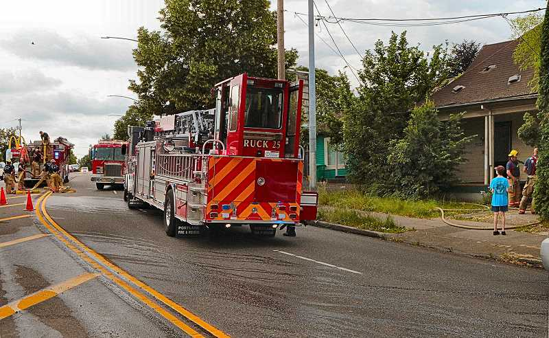DAVID F. ASHTON - S.E. Powell Boulevard was closed to traffic, as firefighters completed extinguishing the house fire near 28th Avenue.