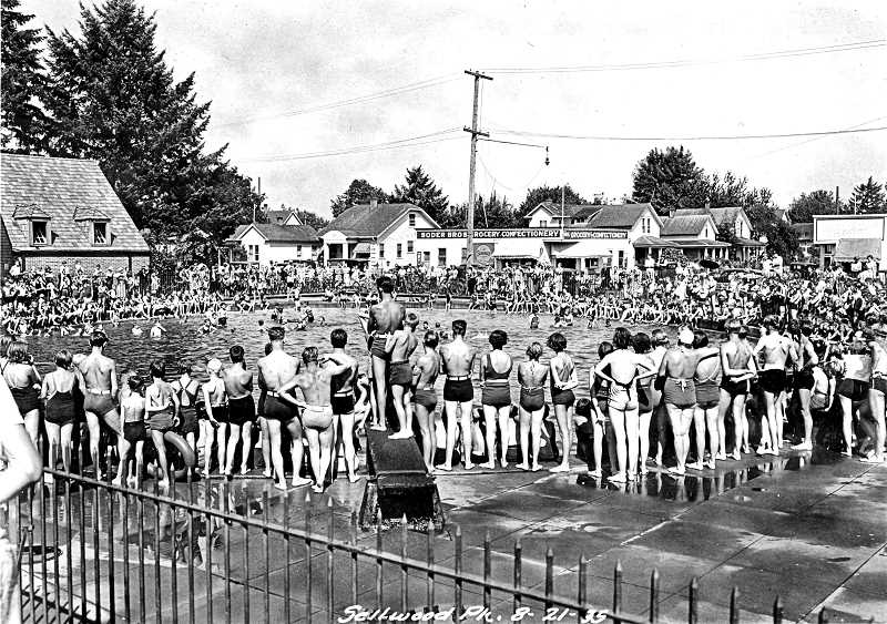 COURTESY OF PORTLAND CITY ARCHIVES - Young swimmers gather to watch an aquatic demonstration at the Sellwood Pool in the summer of 1935. Almost every kid who grew up in the neighborhood spent part their summer swimming at the Sellwood Pool, and after their all-day fun in the water, would stop at the Soder Brothers Grocery Confectionery, or visit the Pleasant Corner Confectionary.