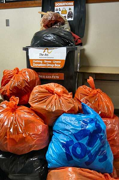 PHOTO COURTESY OF THE ARC - The Arcs collection receptacle at Arleta Elementary School overflows with used clothing - for which the school receives $.20 per pound, benefitting the PTA.