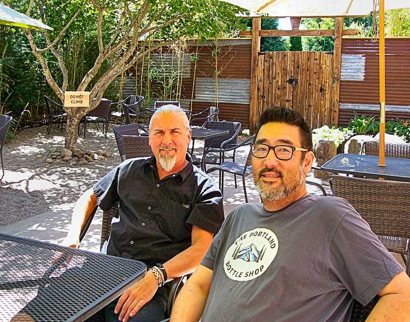 RITA A. LEONARD - On the patio of the new Zenbu Lounge Japanese restaurant on S.E. 17th in Sellwood are bartender Christopher Wells at left, and owner Wes Kasubuchi.