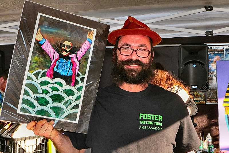 DAVID F. ASHTON - Tasting Tour Ambassador Jason Brown, owner of PoBoy Art & Framing, showed off one of his works - a painting of Tony Clifton, an alter-ego of comedian Andy Kaufman