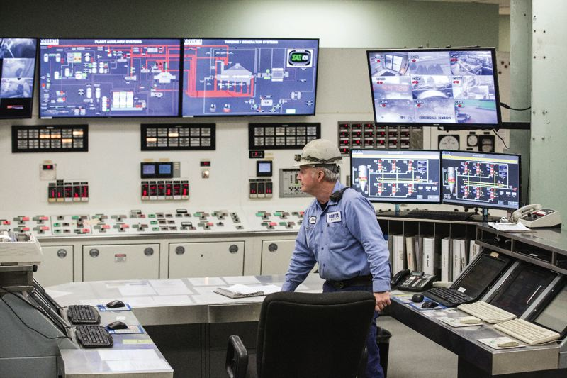 TRIBUNE PHOTO: JONATHAN HOUSE - Doug Piesker runs the control room at Covantas garbage incinerator in Brooks.