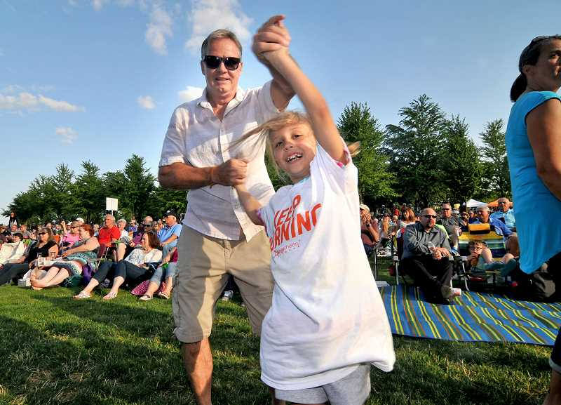 Rick Dir shows Meghan Smith some of his dance moves at Music in the Park July 20.