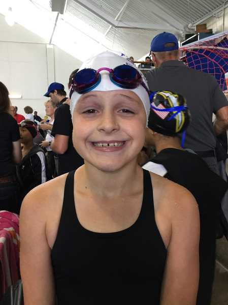 COURTESY PHOTO - Gaston's Sydney McDonald poses for a photo during her swim meet. Sydney took first place in the 50-meter freestyle during the 10-and-under State USA Championship held at the Tualatin Swim Center July 15 and 16.