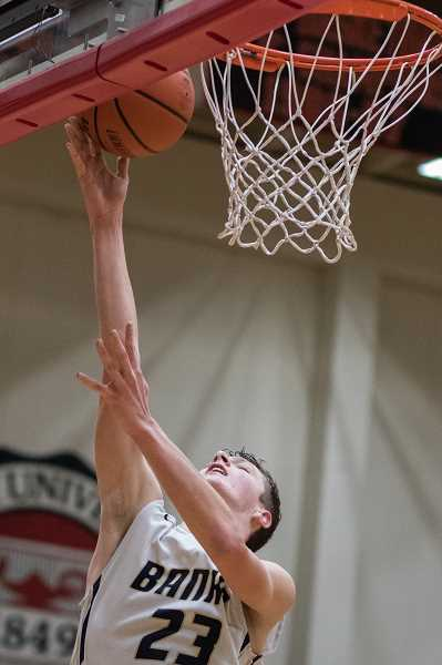 NEWS-TIMES FILE PHOTO: CHASE ALLGOOD - Banks' Dalton Renne goes up for a rebound in the Braves' playoff quarterfinal loss against Tillamook last season.