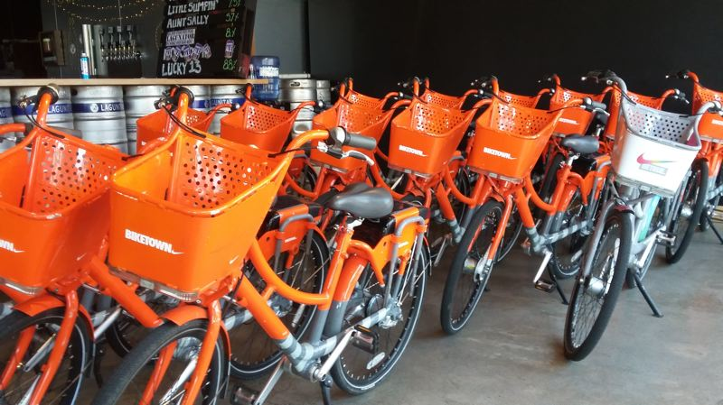 PAMPLIN MEDIA GROUP: OLIVIA SANCHEZ - Shiny orange Biketown bikes are now stationed in North Portland.
