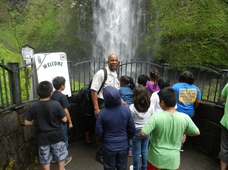 COURTESY OF KEVIN PRICE - Kevin Price has led fourth-graders from King School in Portland to several sites along the gorge for 24 of the past 25 years. Here he is with the group in 2011 at Lower Latourell Falls, which most of the kids had never before explored.