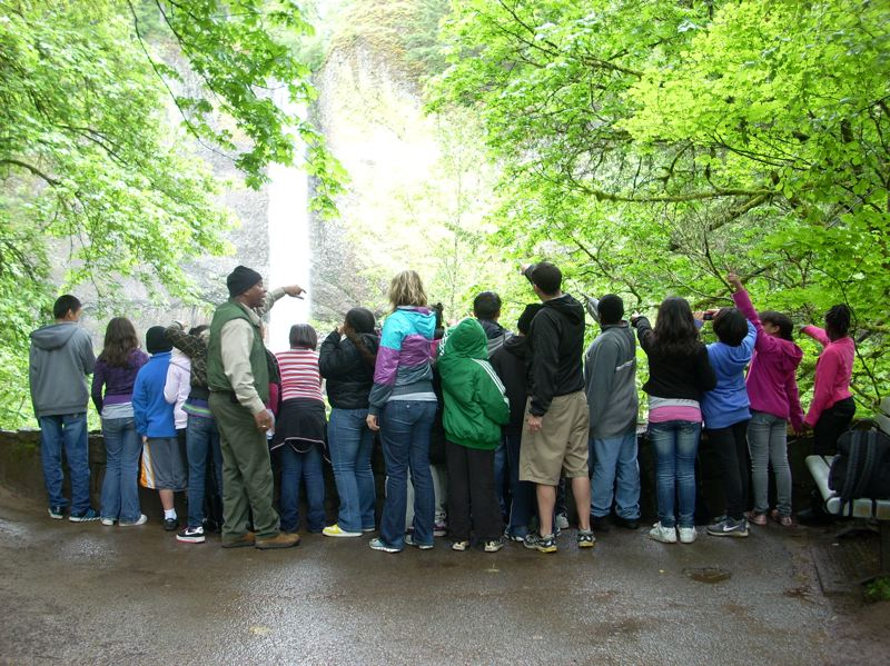 COURTESY OF KEVIN PRICE  - Kevin Price stands with his King School class in 2012 at Multnomah Falls. He also is working with the Black Student Union at Portland State University, leading tours and connecting them with paid internships at Oregon State Parks.
