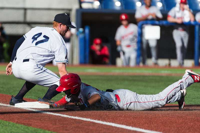 HILLSBORO TRIBUNE PHOTO: CHRISTOPHER OERTELL - Hillsboro Hops first baseman Pavin Smith (47) tries to tag a base runner during the Hops game against the Spokane Indians at Ron Tonkin Field in Hillsboro, July 22.