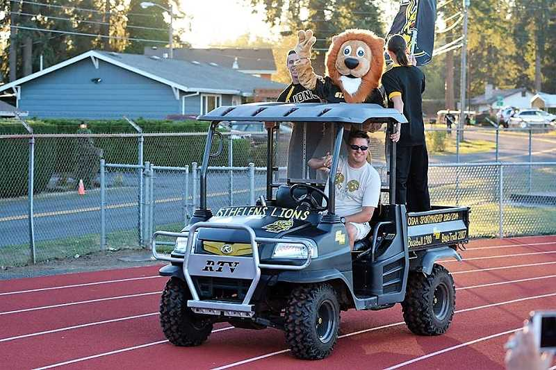 SPOTLIGHT PHOTO: JAKE MCNEAL - Former Lions athletic director Matt Morgan, pictured driving St. Helens High School's Kubota four-wheeler in pre-Seven Mile War football festivities at Doc Ackerson Stadium in 2016.