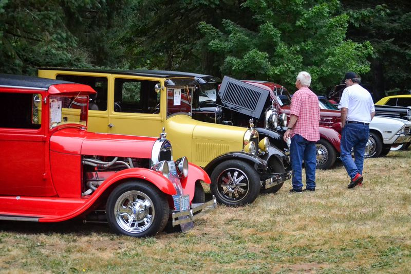 POST PHOTO: BRITTANY ALLEN - People from far and wide have made it a tradition to come eat pancakes and peruse classic cars at the Sandy Kiwanis Fly-In Cruise-In.