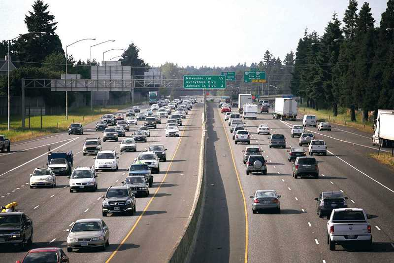 REVIEW FILE PHOTO: KEVIN HARDEN - Evening rush hour begins to clog both directions of Interstate 205 in Clackamas County. A state transportation package includes placing tolls on the popular freeway, from its intersection with I-5 in Tuatatin north to the Washington border.