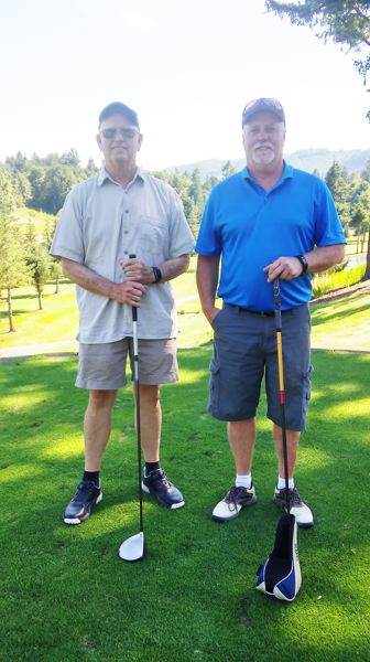 PHOTO COURTESY: ROBERT MEDLEY - Low net champion Jimmie Jeffrey, left, and low gross medalist Tom Schwab, right, led their fields at the St. Helens Men's Club Individual Championship July 22-23 at Wildwood Golf Course in Portland.