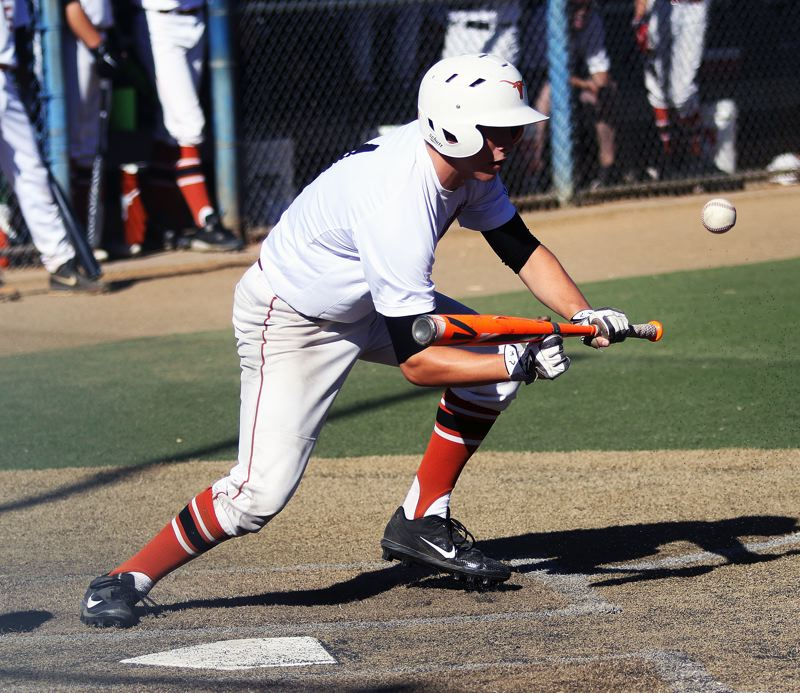 DAN BROOD - Tyler Penn puts down a bunt during the Longhorns' win over Grant.