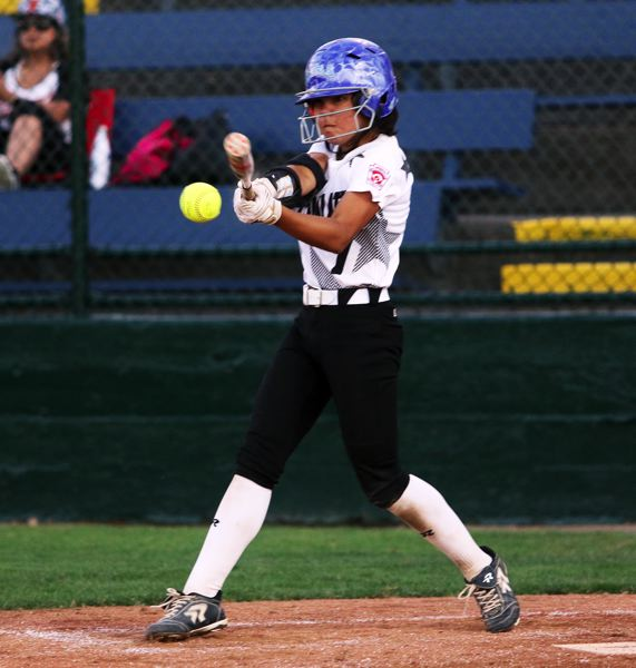 DAN BROOD - Ava Carroll gets her bat on the ball during the victory over Tillamook.