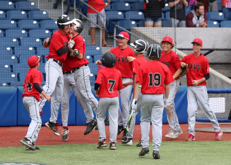 REVIEW/NEWS PHOTO: JIM BESEDA - Clackamas' Will Curran (second from left) celebrates with teammates after his three-run, inside-the-park home run in the seventh inning of Thursday's 5-0 win over Glencoe to open the JBO Senior Federal touranment at Ron Tonkin Field in Hillsboro.