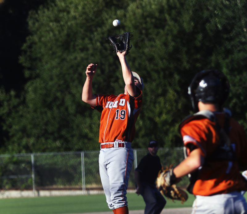 DAN BROOD - Tigard's C.J. Rivers catches a pop-up during the Longhorns' OIBA tourney game with Sunset.