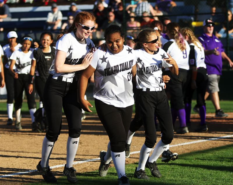 DAN BROOD - Tigard/Tualatin City's (from left) Camille Schmitz, Kani Korok and Talia Valdez are all smiles following the 6-5 win over South Beaverton on Tuesday.