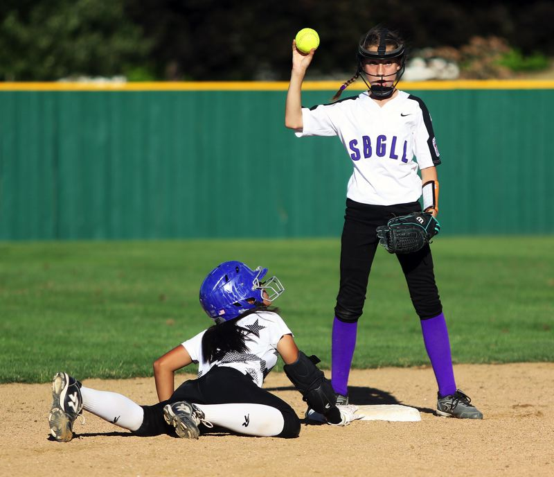 DAN BROOD - Tigard/TC's Ava Carroll (left) is safe at second base during Tuesday's game against South Beaverton.