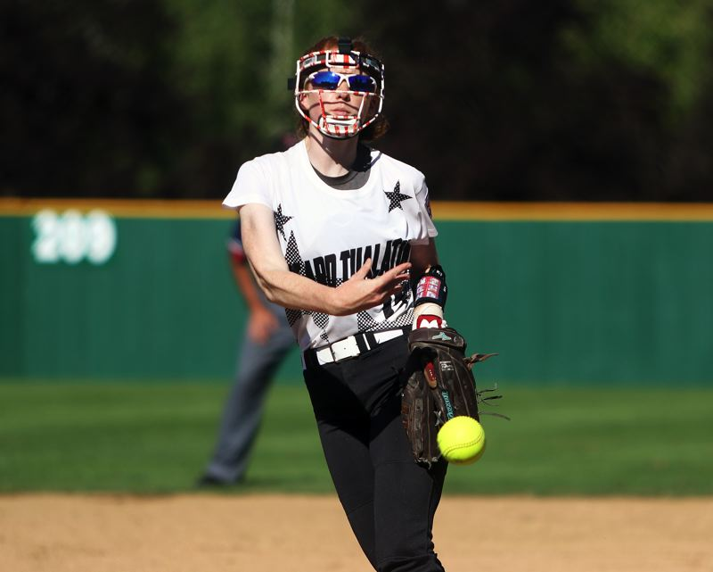DAN BROOD - Tigard/TC's Camille Schmidt fires in a pitch during the first inning of Tuesday's game with South Beaverton.