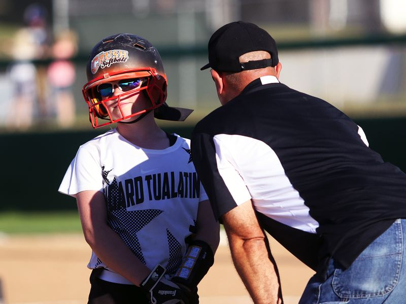 DAN BROOD - Tigard manager Steven Dardis talks to Hannah Wilken during a time out in Tuesday's game.