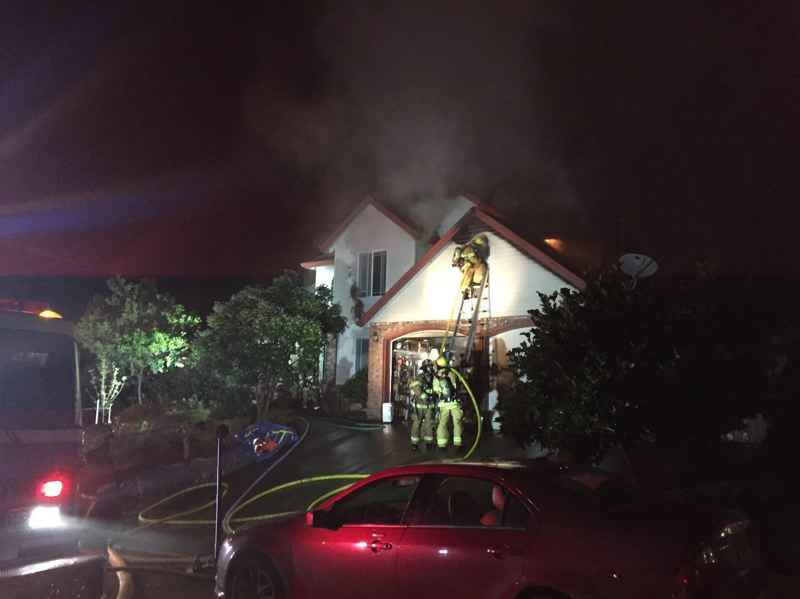 PHOTO COURTESY OF COLUMBIA RIVER FIRE AND RESCUE - Columbia River Fire and Rescue crews respond to a house fire on Steinke Road on Monday, July 24. The fire caused $100,000 in damage and displaced three people who were living in the home.
