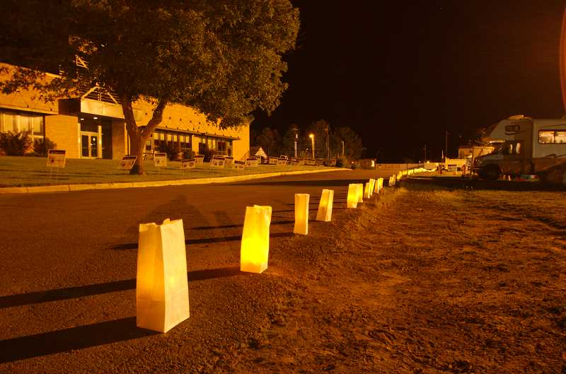 CENTRAL OREGONIAN FILE PHOTO - Luminarias line the track at night.