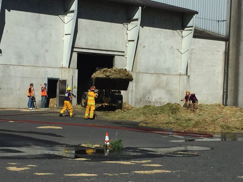 PHOTO COURTESY OF COLUMBIA RIVER FIRE AND RESCUE - Emergency crews were called to Calaway Hay Products in St. Helens on Tuesday, July 25, after a fire broke out in a hay pile. The cause of the fire is believed to have been stored wet hay that spontaneously combusted.
