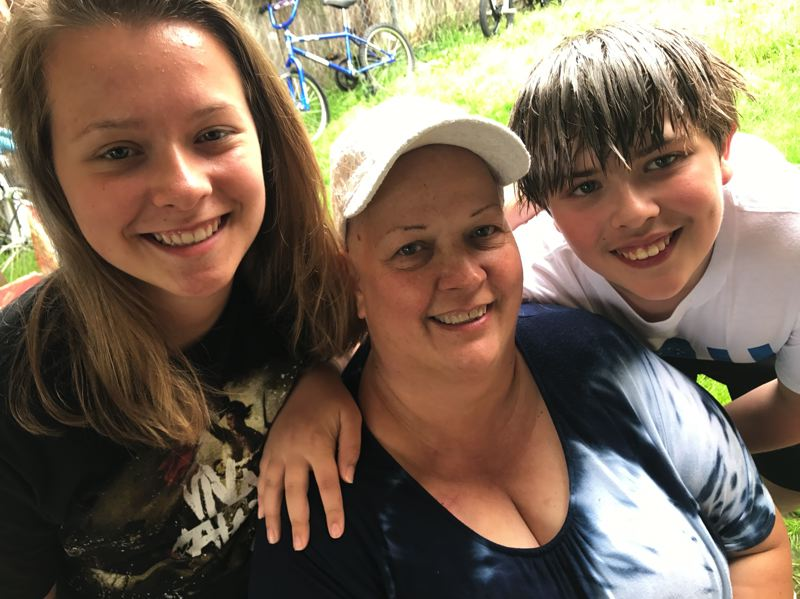 PHOTO COURTESY OF ANDY MCCANDLESS - Ginny Carlson (center) with her children, Kaylee, 16, and Ben, 13.