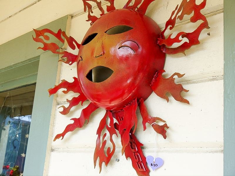 CONTRIBUTED - Tim Foertsch creates a unique metal sun sculpture out of a damaged car panel and propane tank.