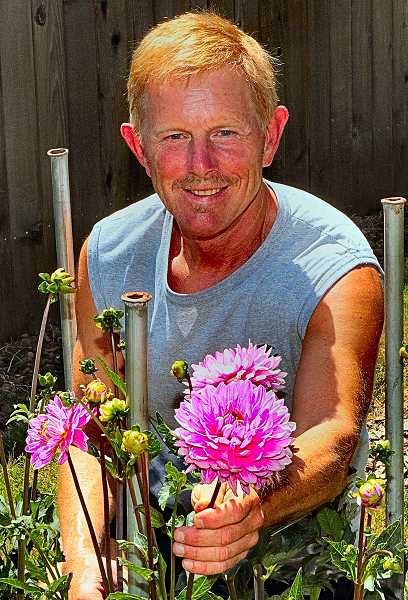 DAVID F. ASHTON - It was growing in his yard in the Foster-Powell neighborhood: Portland Dahlia Society President Larry Smith shows a dahlia named Beginners Luck, which was hybridized by a club member in the Reed neighborhood.