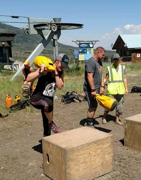 PHOTO COURTESY OF BROOKE SMITH  - Brooke Smith steps onto a 20-inch box while carrying a sandbag during the Train to Hunt National Championships. Smith placed second in the masters division at the event, which was held in Mesa, Colorado.