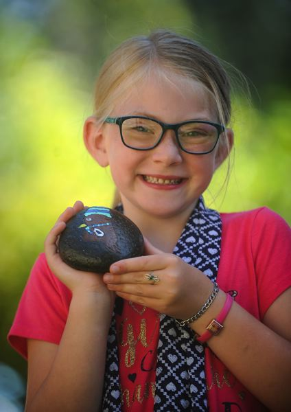 OUTLOOK PHOTO: JOSH KULLA - Sarah Bourgeois' 6-year-old daughter Sadie shows off one of her mother's creations.