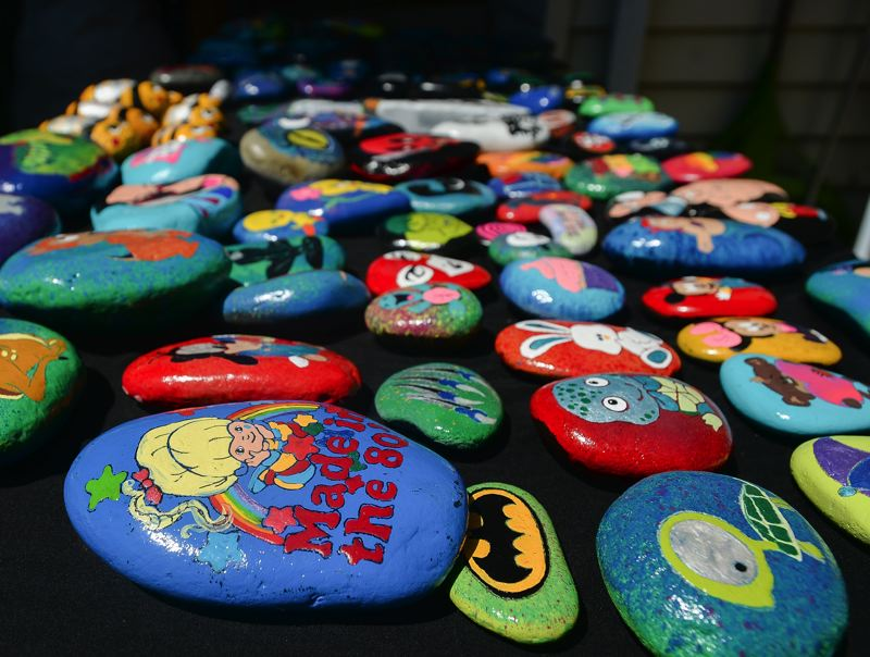 OUTLOOK PHOTO: JOSH KULLA - This is just one portion of the  more than 1,000 painted rocks in Sarah Bourgeois' collection.