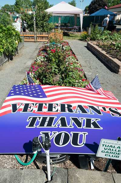 NEWS-TIMES PHOTO: CHRISTOPHER OERTELL - The demonstration gardens, where the new Veterans Memorial Garden is located, received more than 1,300 visitors opening day of the fair, according to Master Gardener Margery Brunello, who co-coordinating fair activities with fellow Master Gardener Jeannine Rychlik.