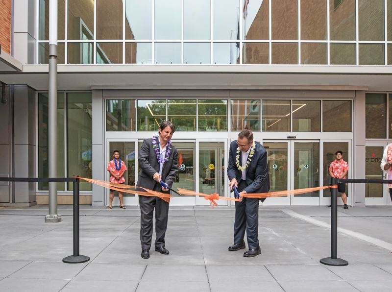 TRIBUNE PHOTO: JONATHAN HOUSE - Todd Minnis (left), Managing Partner at CAPREF Lloyd Center, and Robert Dye, General Manager of Lloyd Center, cut the ribbon on the new grand entrance to the mall, designed to lure more people in from the Holladay Park side.