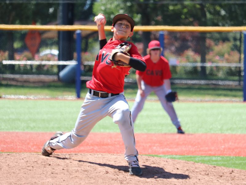 REVIEW/NEWS PHOTO: JIM BESEDA - Caden Miller drew the start for Clackamas and pitched into the fifth inning of Saturday's 10-5 loss to Sunset at Ron Tonkin Field in Hillsboro.